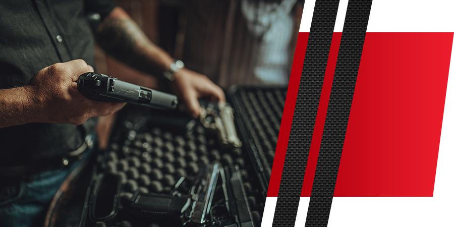 Man-taking-guns-out-of-a-case